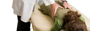 Carbondale Chiropractor Adjusting Woman's Back